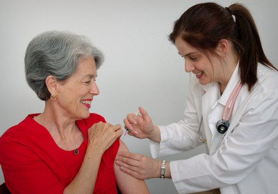 15813-a-senior-woman-receiving-a-vaccination-shot-from-her-doctor-pv